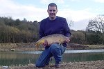 Ian Tucker with a 14lb 2oz Century Mirror (click to enlarge). Photo by Jason Allen.