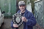 Match winner Ian Tucker with the George Bingham Shield (click to enlarge). Photo by Jason Allen.
