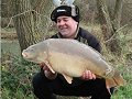 Rob Lansdown with a personal best Carp of 21lb 9oz, caught on the 'wrong rod' (photo by Ben Groom)